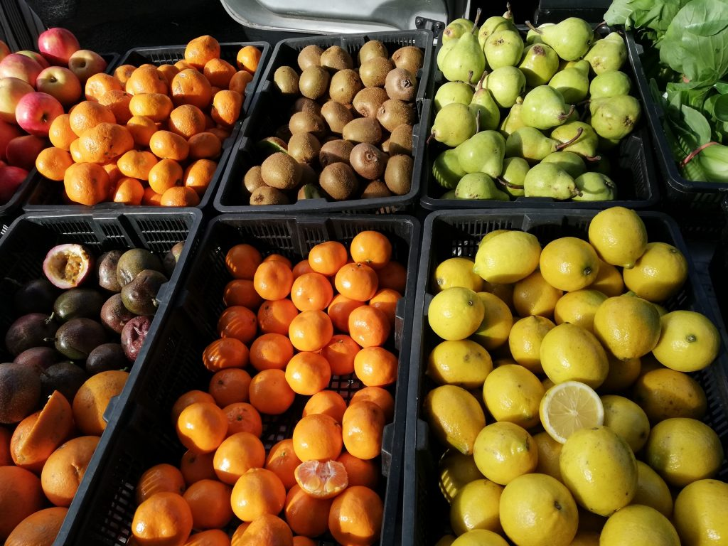 Oranges, lemons, pears, kiwi fruit at a market