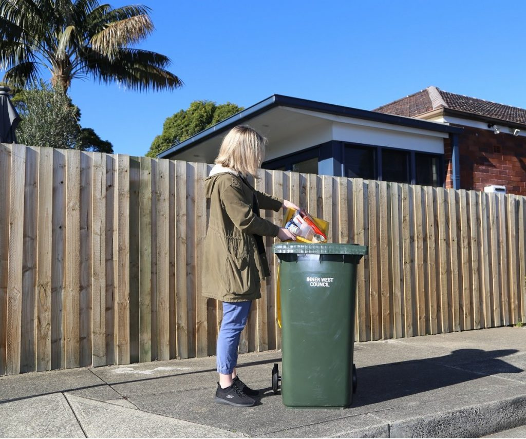 Woman putting recycling into a bin