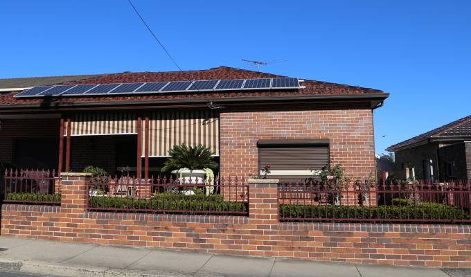 Red brick house with solar on the roof